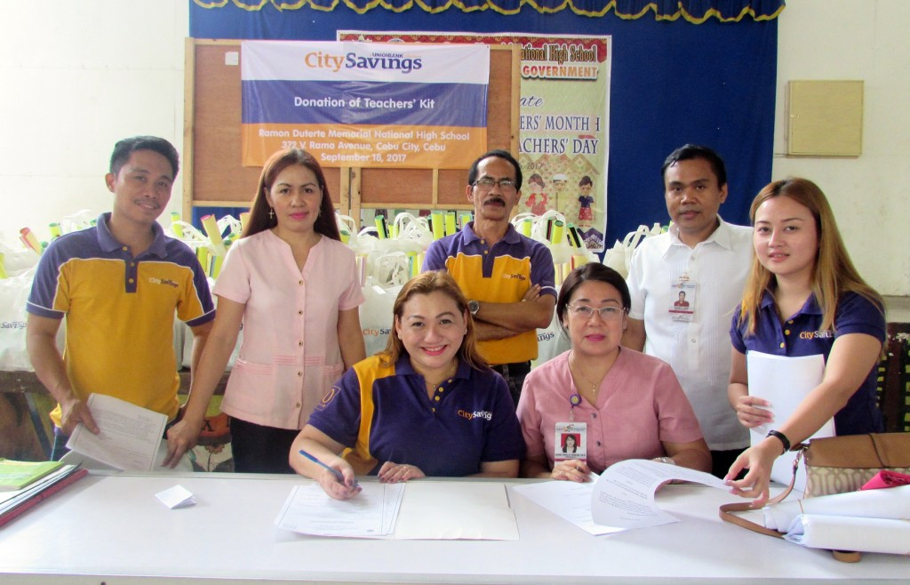 TEACHING KITS: Representatives from City Savings Bank led by Reputation Management Head Paula Ruelan (seated, left) and Branch Business Head Sedrick Sesante (standing, 3rd from left) and Ramon Duterte Memorial National High School headed by Principal Eileen Irina Tayactac, during the Memorandum of Agreement signing last September 18.