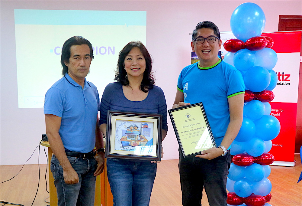 DepEd Batangas Division Supervisor David Nuay presents APRI with a special plaque signed by DepEd Sec. Leonor Briones to APRI VP-Corporate Services Officer Noemi Sebastian and Reputation Manager Apa Alviar.