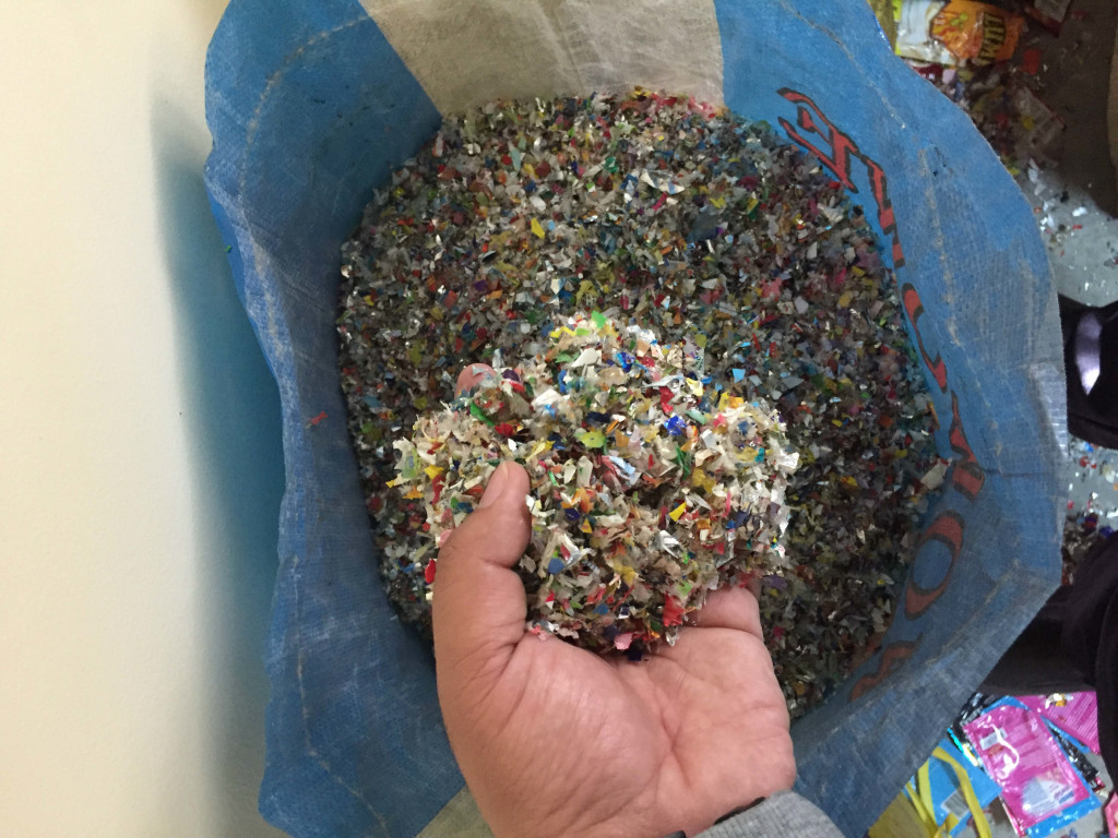 The shredded plastic is used as a component in making the bricks for footpath and plant bricks.