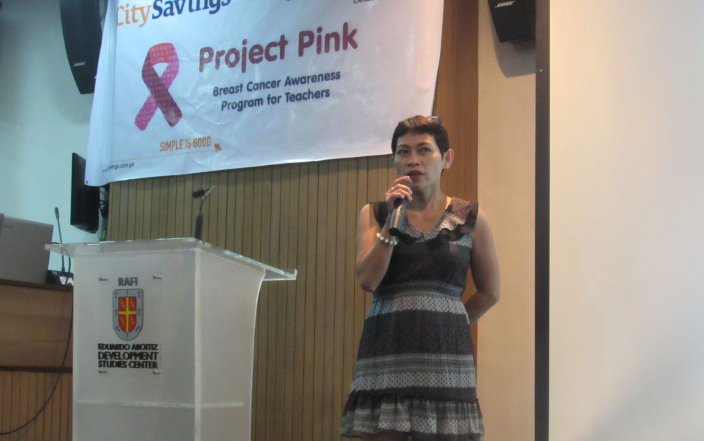 BREAST CANCER WARRIOR: Nora Moreno, guest speaker and a breast cancer survivor shares her testimonial on her triumph over breast cancer during the Project Pink forum last March 23 at EADSC, Cebu City.