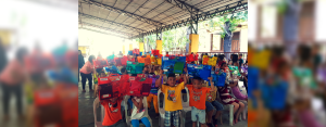 Grade 1 pupils of San Nicolas Elementary School in Cebu City proudly display their envelopes containing school supplies that they received from VECO employees.