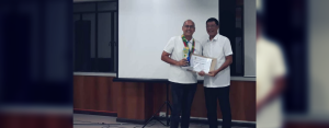 SacaSun Community Relations and Compliance Officer Raymond Peter Rigor (left) receives a plaque of recognition from San Carlos City Vice Mayor Rene Gustilo during San Carlos City's fellowship night for the top local taxpayers last July 5.