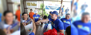 VECO Kaibigans bring a smile to one of the evacuees at Enan Chiong Activity Center as they distributed relief goods to landslide victims in the City of Naga, Cebu last September 22.