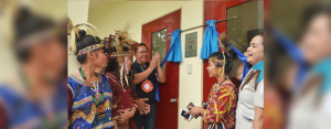 CHEERS TO BETTER EDUCATION FOR IPs. Hedcor Vice President for Operations Rolando Pacquiao and Mt. Apo National High School Teacher-In-Charge Marites Chan unveil the Marker of Partnership witnessed by MANHS students in their Bagobo-Tagabawa tribal costume.