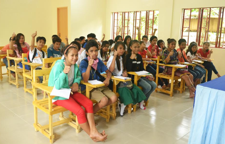 THUMBS UP FOR THE NEW CLASSROOMS. Mt. Apo National High School students try out their new classroom furnished with facilities that enable motivation and learning among the learners and teachers.
