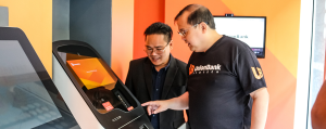 UnionBank President Edwin Bautista checking out the country's first virtual currency ATM.