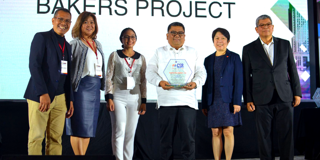 """Aboitiz Foundation representatives receiving the Finalist trophy for the """"Noble Bakers"""" Project."""