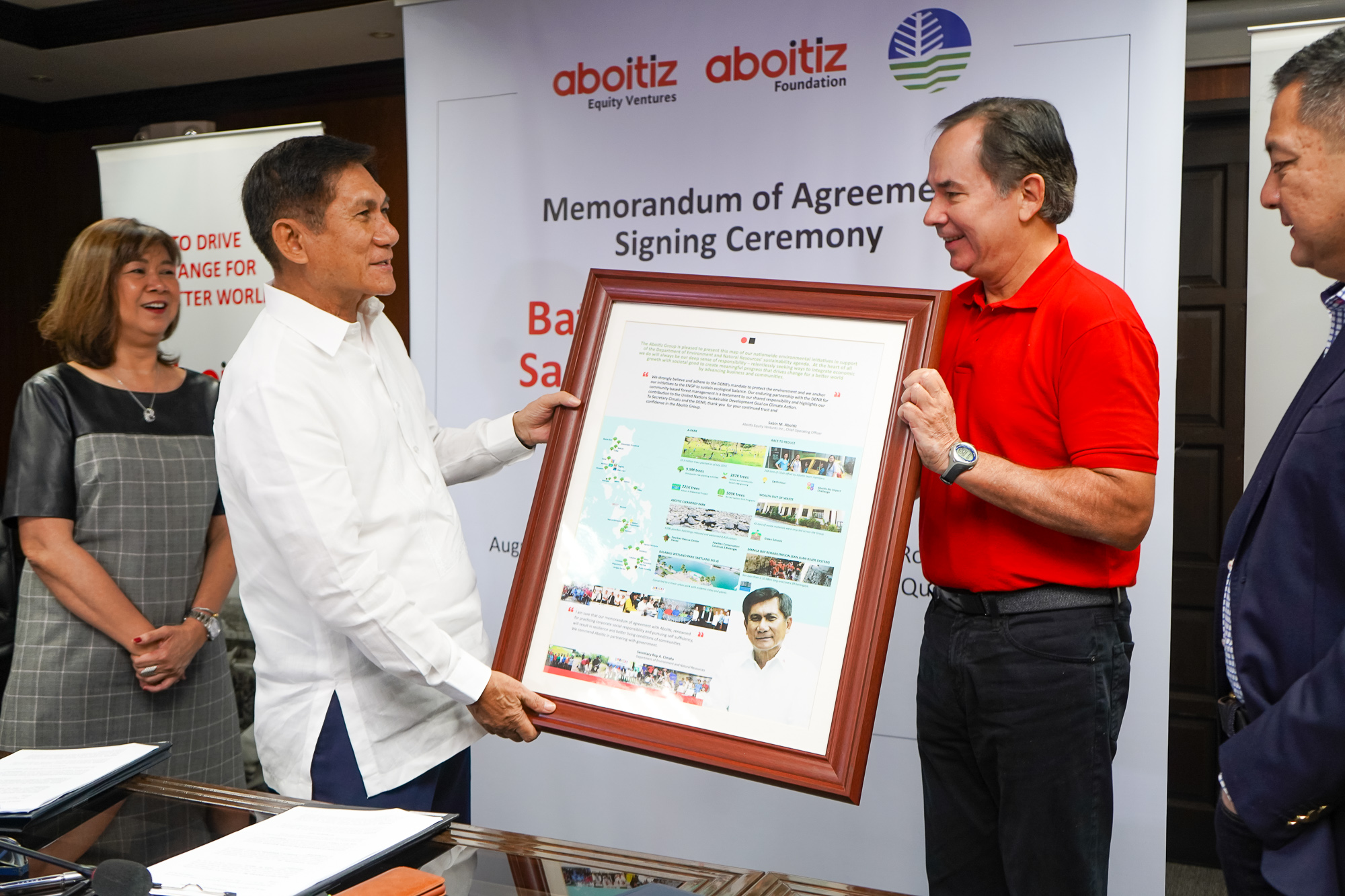 The Aboitiz Group presented Sec. Cimatu with a framed infographic of our groupwide environmental sustainability programs across the country.