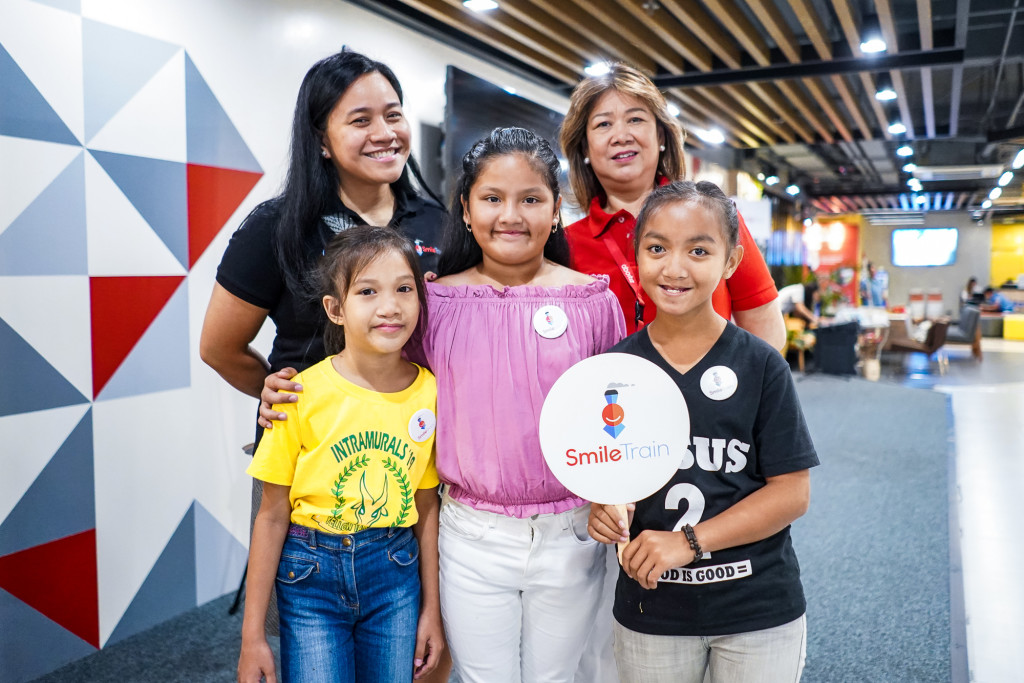 Smile Train Area Director Kimmy Flaviano and Aboitiz Foundation COO Maribeth Marasigan with Cheska and fellow Smile Train kids.