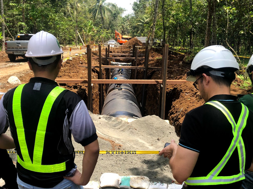 PENSTOCK - Penstock pipe-laying is ongoing and includes welding of pipe lengths and leak testing.