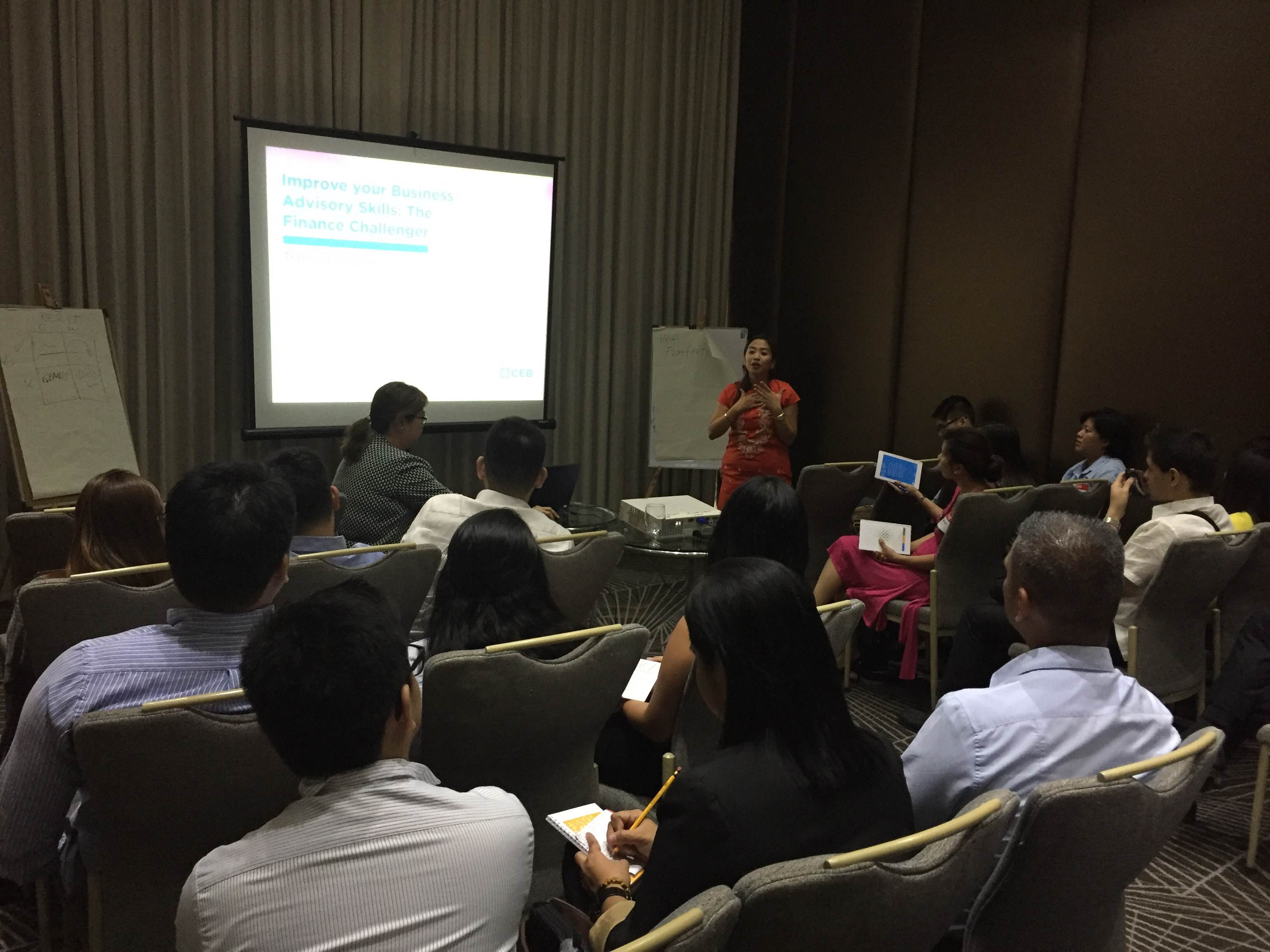 """Finance Mentoring Cluster members look on as AboitizPower CFO and guest speaker Liza Montelibano presents the Finance Challenger Framework at the kick-off session held at the F1 Hotel on April 25."""""""