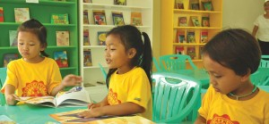"""TURNING A NEW PAGE. Preschoolers of Ana-ao Elementary School have access to a wealth of new reading materials at their own Silid Pangarap brought to them by Luzon Hydro Corporation.BETTERWORLD EDUCATION. """"When we build more schools, we open more doors of limitless possibilities,"""" said Atty. Jill Verallo, VECO's Reputation Enhancement Department Head at the turnover ceremony in Cebu.NEW SILID PANGARAP. Tamiao Elementary School Principal Meriam Geray, AboitizLand AVP for External Affairs (VisMin) Anthony Noel, Compostela Municipal Mayor Joel Quiño, Aboitiz Foundation Executive VP Augusto Carpio III open the one-storey, two-classroom AGAPP kindergarten school building at Tamiao ES, Tamaio, Compostela, Cebu, last October 21."""