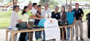 SWITCH ON. Davao Light EVP and COO Arturo Milan (5th from right) leads the ceremonial switchon at Brgy. Buda with other company executives, representatives of the Bureau of Fire Protection, FIBECO, and the local government.