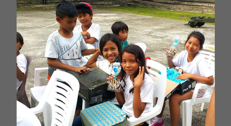 OPENING HOPE IN A SHOEBOX. Students smile at the goodies they received from Project Shoebox, a corporate citizenship initiative spearheaded by the Government Relations team of AEV, Aboitiz Foundation and Pilmico in partnership with the Philippine Army Artillery Regiment (AAR).