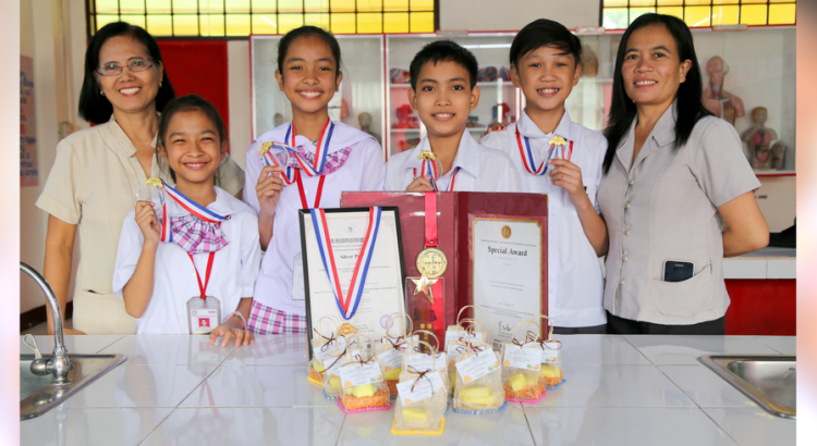 SCIENCE IS WINNING. Taguig Integrated School's young inventors wowed the competition judges with their ingenious mosquito repellant lotion bar.