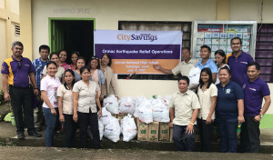 BUILDING A COMMUNITY OF HOPE: Educators and their families from Lim-ao National High School in Kananga, Leyte receive food and hygiene kits during the relief operations by City Savings Bank spearheaded by Ormoc Branch team members.