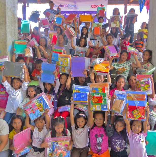 READY TO LEARN. Otucan kids receive school supplies from Hedcor.