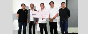 Making 'safety' a habit. Mitsuji Kuroda (center) of the Mindanao Kokusai Daigaku (Mindanao International College) receives the plaque and cash prize worth Php45,000 for winning 1st place in the Davao Light's 4th short video-making contest. The team of Kuroda's simplicity and creative depiction of the theme in their entry entitled Safety: Make It A Habit captured the judges in this contest.