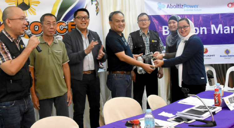 Ceremonial Turnover. In photo (from left to right) are USec. Falconi V. Millar, Secretary General of HUDCC; Ramon Carlos O. Florese, NEA Acting Director; Christopher M. Camba, VP for Government Relations of Aboitiz Equity Ventures; Mark A. Velencia, AVP for Engineering of Davao Light and Power Co., Inc.; Sec. Eduardo D. del Rosario, Chairman of Task Force Bangon Marawi; Omikhalsom Maruhom, Paralegal of LASURECO; and Atty. Mhyra Jane M. Abbas, Executive Secretary of LASURECO.