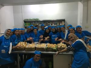 "Beneficiaries of ""PAGKAIN Biyaya ng Pagbabago Bakery Livelihood Program"" proudly showing the bread and pastries they baked"