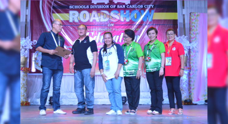 PARTNERSHIP. San Carlos Sun Power Inc. (SacaSun) Community Relations and Compliance Officer Raymond Peter Rigor (left) receives a certificate of recognition from the Department of Education (DepEd) during a recent caravan in San Carlos City.
