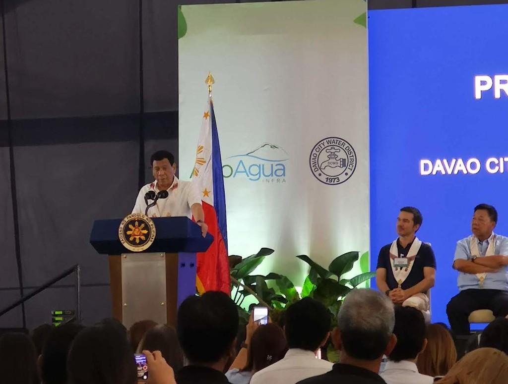 President Duterte addresses the audience at the Apo Agua construction kick-off with Apo Agua president Romàn V. Azanza III looking on.