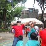 Trying a shotblock while playing with kids who were part of the Aboitiz Christmas Outreach