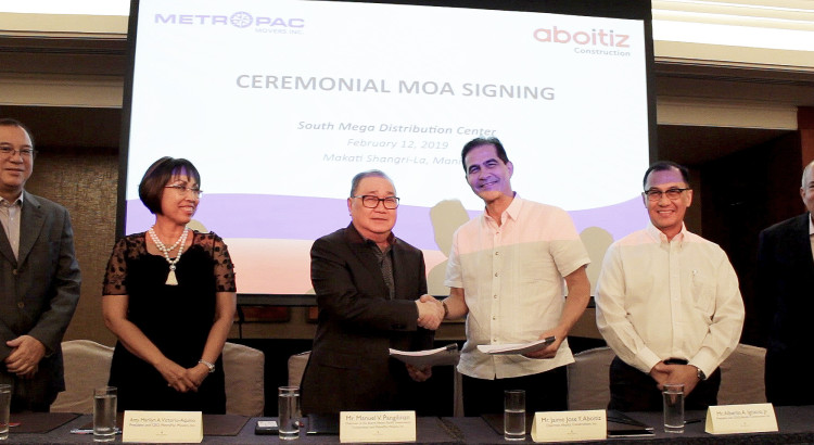 CELEBRATING A NEW PARTNERSHIP. MetroPac Movers, Inc. Chairman Manuel V. Pangilinan and Aboitiz Construction Chairman Jim Aboitiz lead the signing of the Memorandum of Agreement that will bring together the two companies to build one of the largest logistics hubs in the country. With them are (L-R): Metro Pacific Investments Corporation President and CEO Jose Ma. Lim, MetroPac Movers, Inc. President and CEO Marilyn Vicotrio-Aquino, Aboitiz Construction President and COO Albert Ignacio, and Aboitiz Equity Ventures President and CEO Erramon Aboitiz.