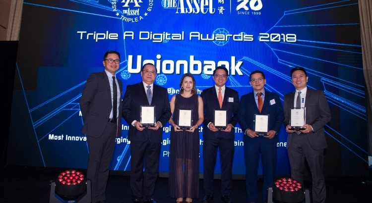 UnionBank President and CEO Edwin Bautista leads the Bank's officials in receiving their five awards from The Asset in a ceremony at the Four Seasons Hotel in Hong Kong. With him are (from left) UnionBank Vice President for Corporate Media Affairs James Ileto, Senior Vice President and Chief Customer Experience Officer Ana Delgado, Customer Experience Designer AJ Atienza, Executive Vice President and Chief Information Officer Dennis Omila and Customer Experience Designer Ron Batisan.
