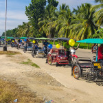 Pedicab drivers participate in a motorcade through portions of Ampatuan to promote the opening of the new PERAHUB.