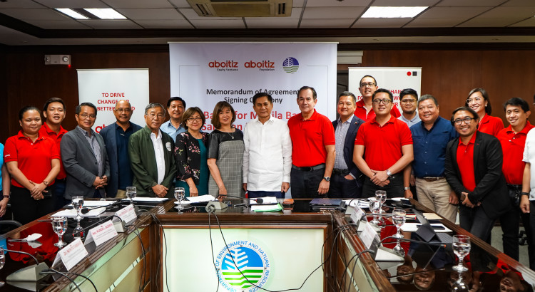DENR Sec. Roy Cimatu (center) is flanked by Aboitiz Foundation COO Maribeth Marasigan and AEV COO Sabin M. Aboitiz at the MOA signing ceremony held at the agency's Central Office in Quezon City; joining them are (from left) Asst. Secretary Ricardo Calderon, Forest Management Bureau Director Nonito Tamayo, Chief of Staff Undersecretary Rodolfo Garcia, members of Aboitiz External Relations and Sustainability teams, and Solid Waste Management and Local Government Concerns Undersecretary Benny Antiporda.