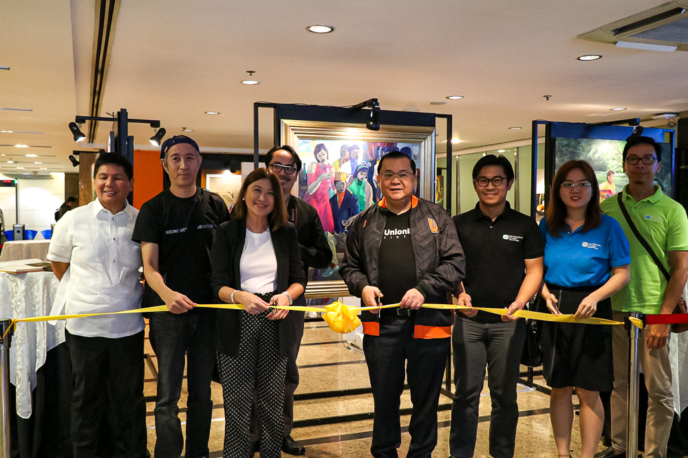 The launch of the third A heART U Share exhibit was led by (from left) UnionBank Commercial Banking Center Head Robert Abastillas, AAA President Frederick Sausa, UnionBank HR Director Michelle Rubio, Kim Unidad, UnionBank President Edwin Bautista, SOS Children's Villages Corporate Relations representatives Admore Alzatte and Ruth Angeli Pascua, and Angono artist Dennis De Vera.