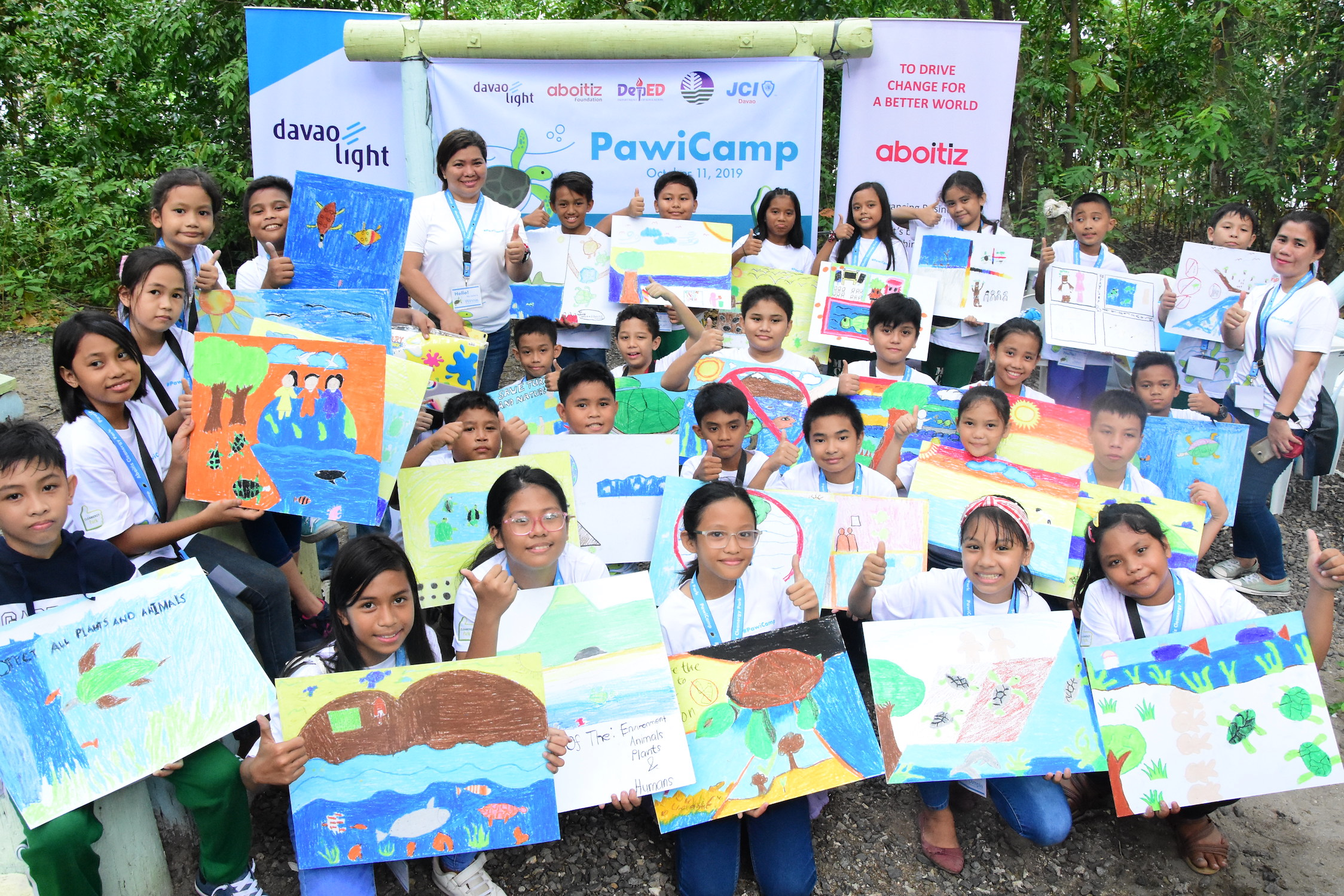 ABOITIZ PAWICAMP-ERS HELP SAVE PAWIKANS. Thirty Davao City students signed up for the first-ever Aboitiz PawiCAMP, a day camp dedicated to the protection and preservation of sea turtles or pawikan in the area. Seen here are the student-campers showcasing drawings of activities that they can do to help save the endangered pawikan.